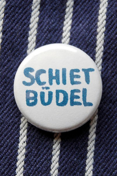 Button, Shietbüdel