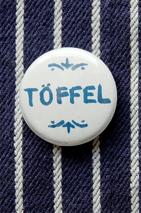 Button, Töffel